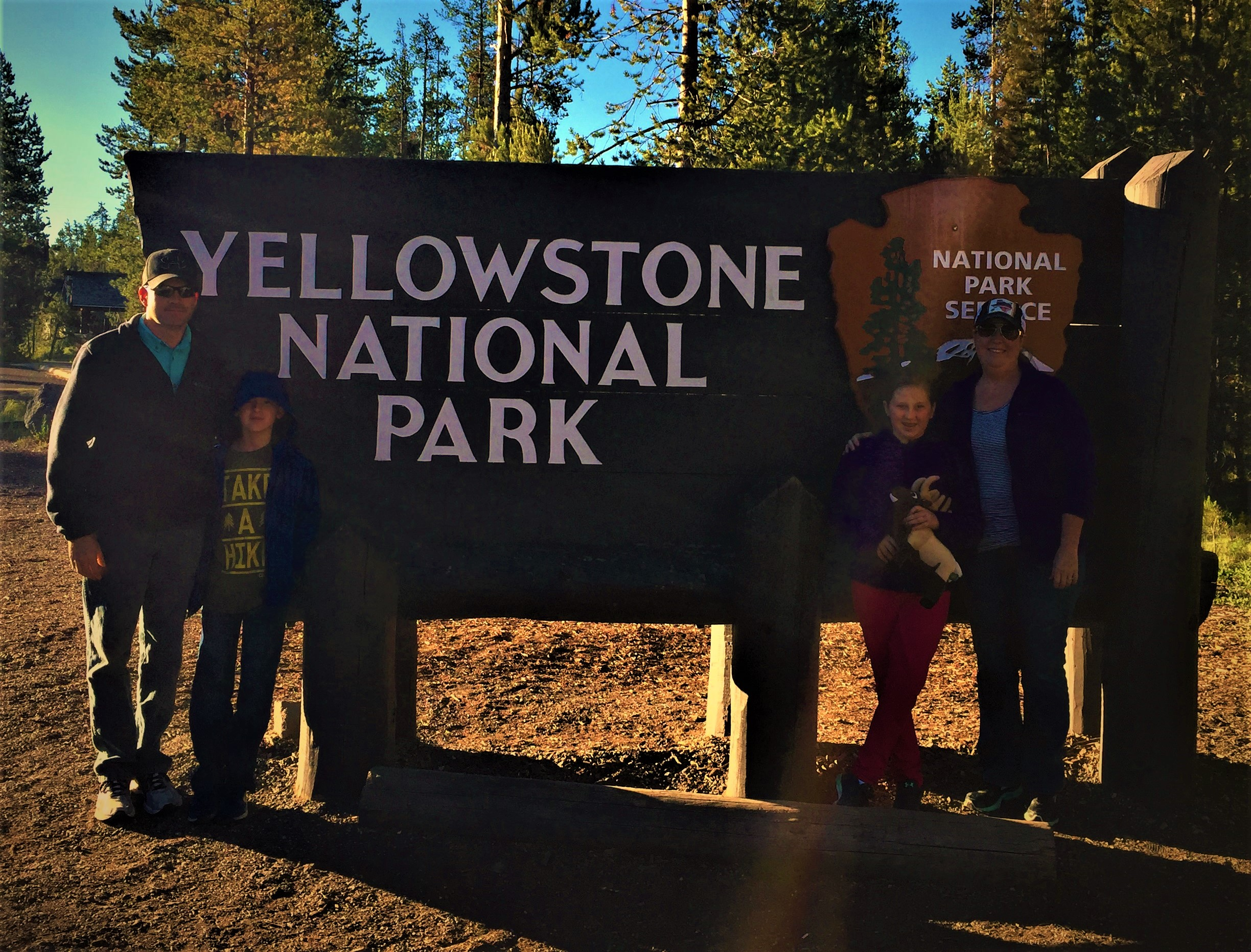 Morris Family at the Yellowstone Sign