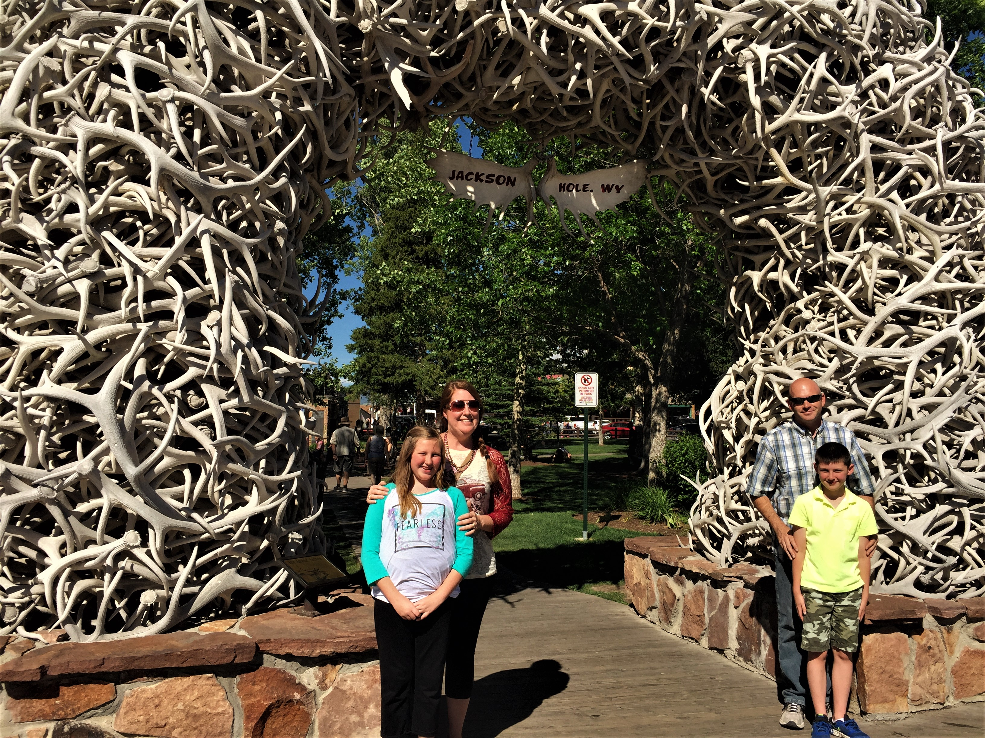 When we returned to Jackson, we went back to the center of town, walked along the wooden boardwalks and did a little shopping. There are many photo galleries, art galleries and tourist shops filling the blocks around the square. Two of our favorites were the Mangelsen Images of Nature Gallery and Teton Toys. These two stops were polar opposites. While visiting the gallery, we were amazed by the beautiful images of nature caught by Thomas D. Mangelsen, one of the world's premier nature photographers. The kids loved viewing all of his photographs, particularly the ones of wildlife. We were sure to keep the kids by our side, because we were afraid someone would touch something they should not, but the worry was worth it! After visiting several more stores and doing a little window shopping, we stumbled across Teton Toys. The kids loved this store, and we did not have to worry about them touching anything. There were toys out for them to play with, and they particularly loved the large selection of stuffed animals depicting local wildlife. Of course, the kids could not leave without purchasing a stuffed gray wolf and an elk.