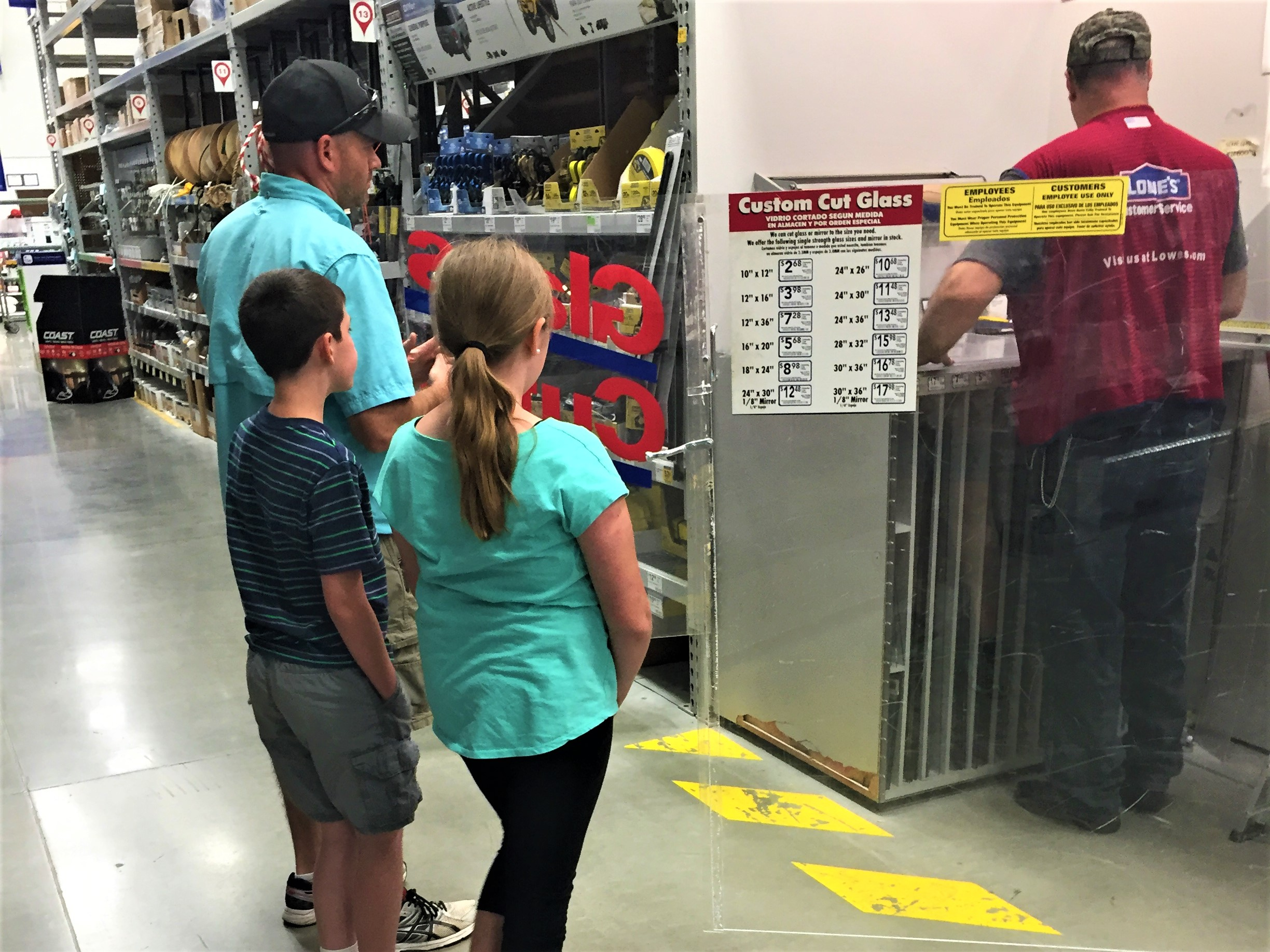 Buying Plexiglass at Home Depot to fix our RV window.